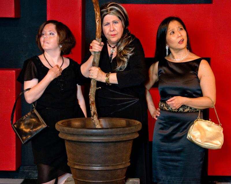 Actresses around a cauldren.