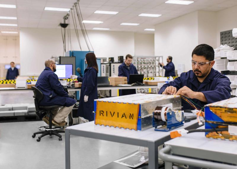 A Rivian employee in California applies the final touches to our battery modules by installing temperature sensors.