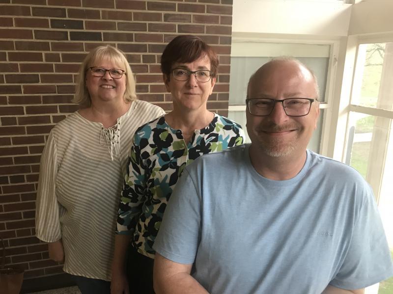 From left, Indivisible local leaders Susan Cortesi, Kerri Calvert, and Patrick Cortesi.