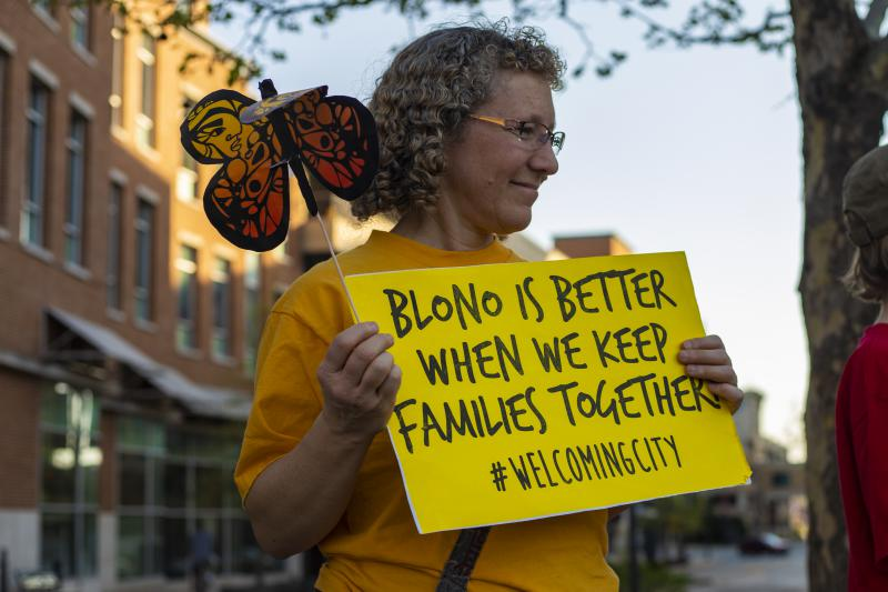 Supporters of the Welcoming Community ordinance rally in Uptown Normal on Monday, May 7, 2018, before the Normal Town Council meeting.