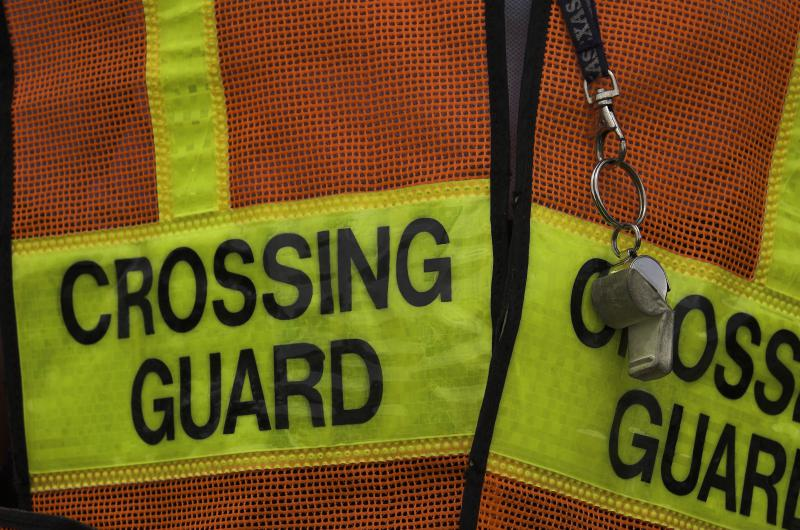 Crossing guard vest and whistle