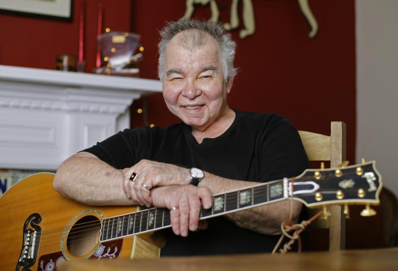 John Prine poses in his office in Nashville, Tenn., in 2017.