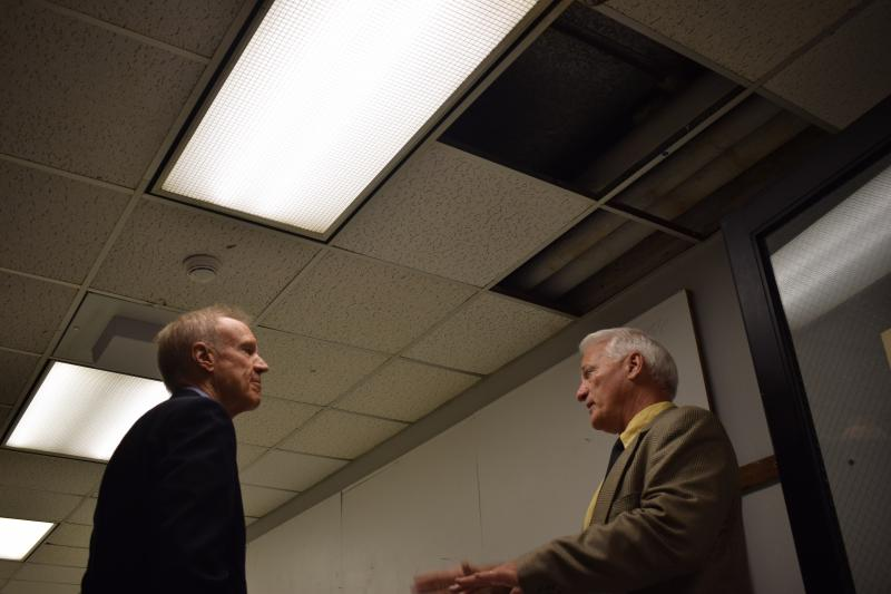 Gov. Bruce Rauner tours Illinois State University's Fine Arts facilities, where damage from a leaky roof is seen on Thursday, June 21, 2018.