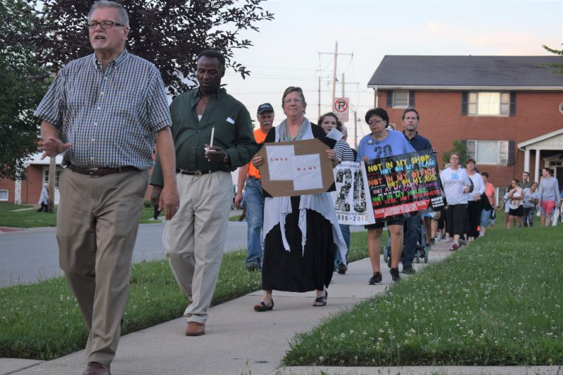 Neighbors participate in a prayer walk on Riley Drive in Bloomington on Sunday, June 24, 2018.