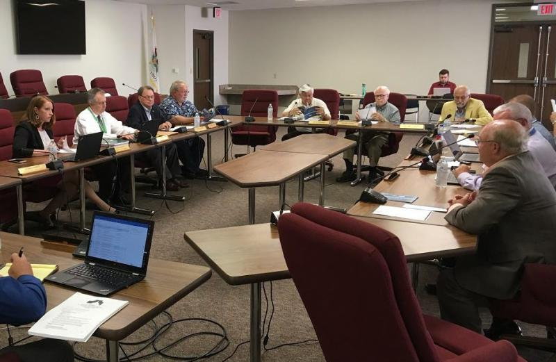 Mike O'Grady, far right, of the Bloomington-Normal Economic Development Council presents a report Tuesday to the McLean County Board Executive Committee.