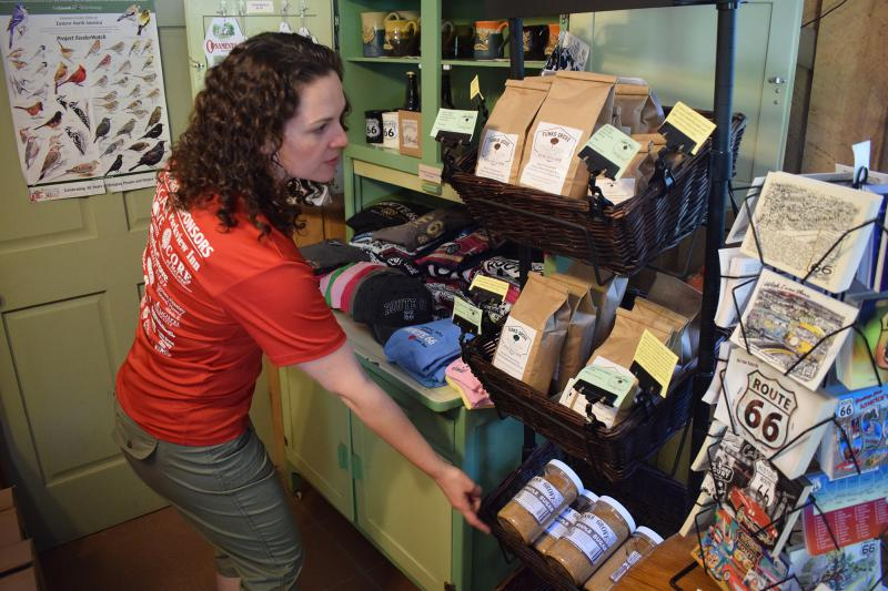 Katie Funk shows off Funks Grove Heritage Fruits and Grains products at the sirup shop.