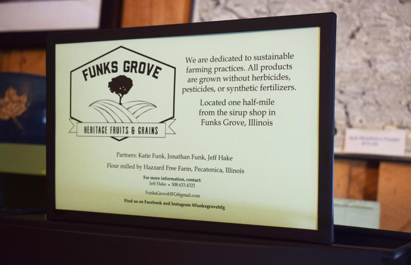 A Funks Grove Heritage Fruits and Grians sign at the sirup shop.