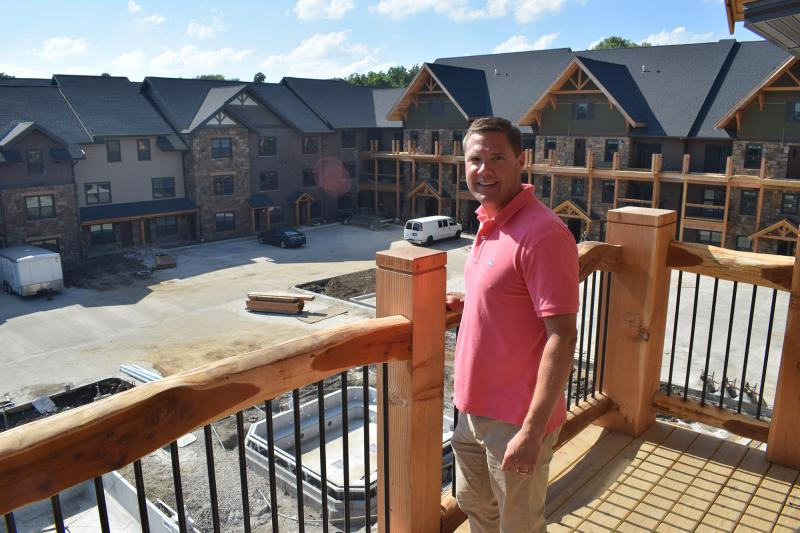 Andy Netzer on a balcony overlooking the Lodge
