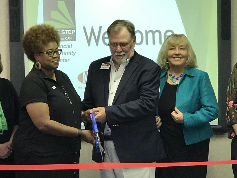 From left, LISC of Greater Peoria Executive Director Karen Davis, MCCA Board President Terry Lindberg, and MCCA Executive Director Deborah White cut a ribbon to open the Financial Opportunity Center at MCCA on Wednesday, July 25, 2018.