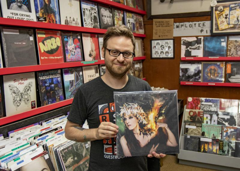 "Waiting Room Records owner Jared Alcorn with the ""Hell-On"" album from Neko Case."