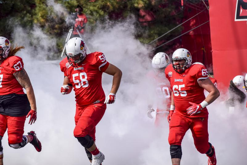 78297cb557a Redbird football players come onto the field for the 2017 Homecoming game  at Hancock Stadium.