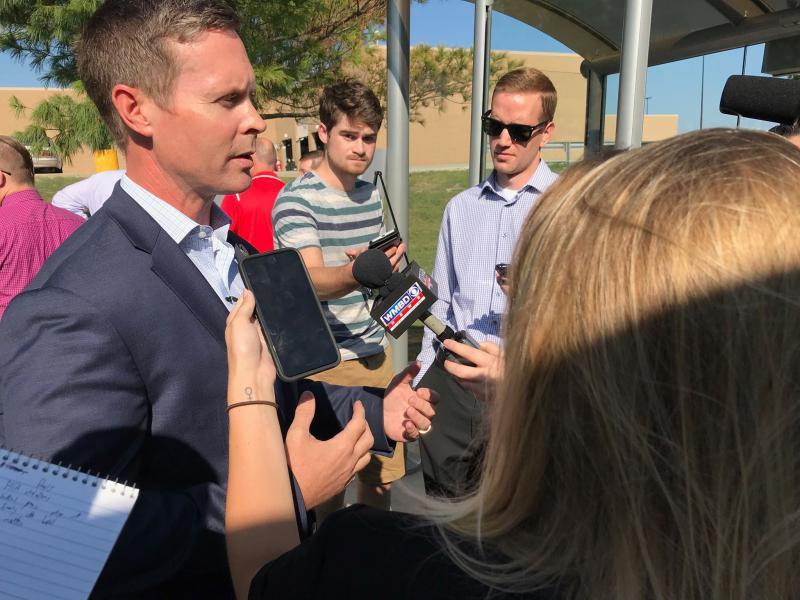 Rodney Davis speaks to reporters