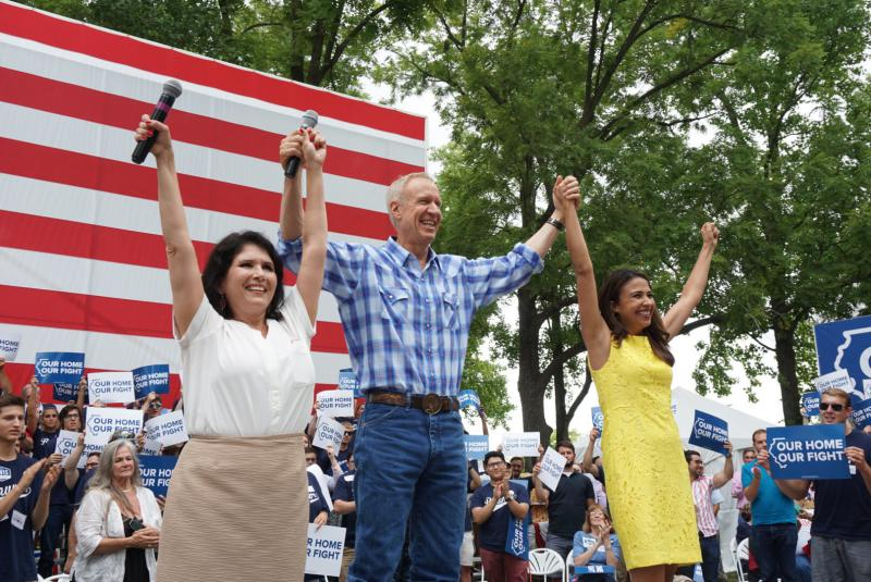 Gov. Bruce Rauner with, left, Lt. Gov. Evelyn Sanguinetti and attorney general candidate Erika Harold on Wednesday, Aug. 15, 2018, in Springfield.