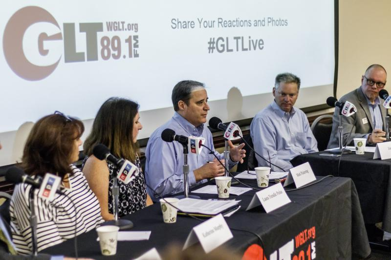 Panelists speak at GLT event