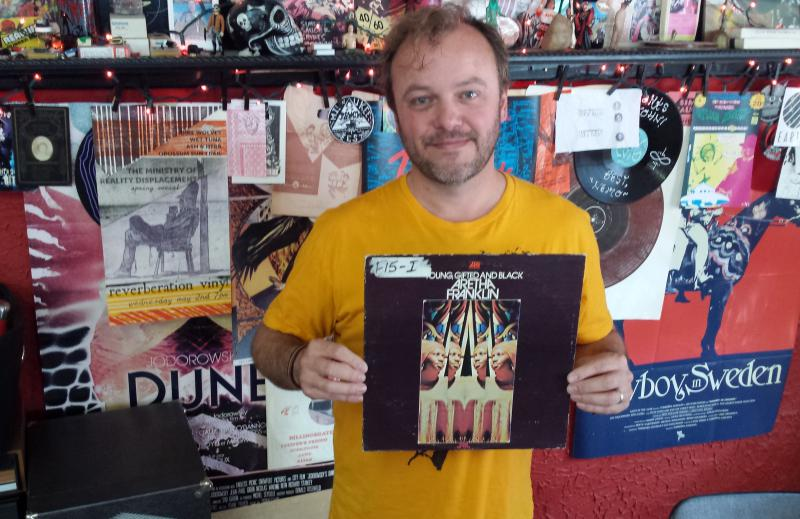 Reverberation Vinly's John Anderson holding Aretha Franklin's 'Young, Gifted and Black