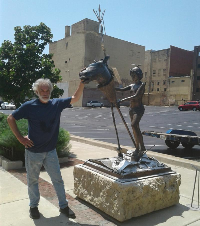 Herb Eaton with his sculpture 'Mommy's Broom'