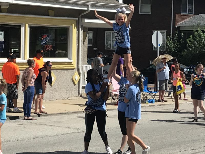 A cheer group does a stunt.