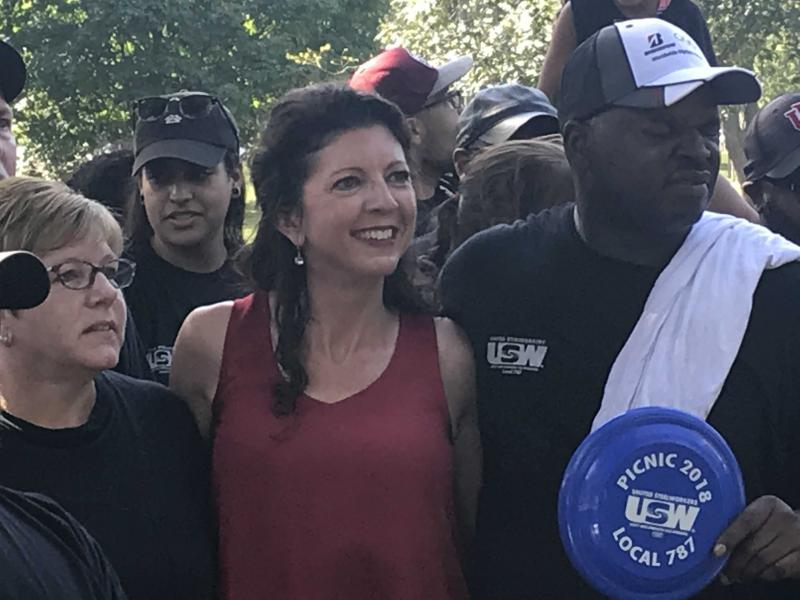 Londrigan stands with other Democrats at Miller Park in Bloomington