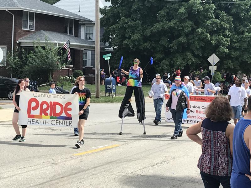 The Pride Health Center banner advancing along Wood Street in Bloomington.