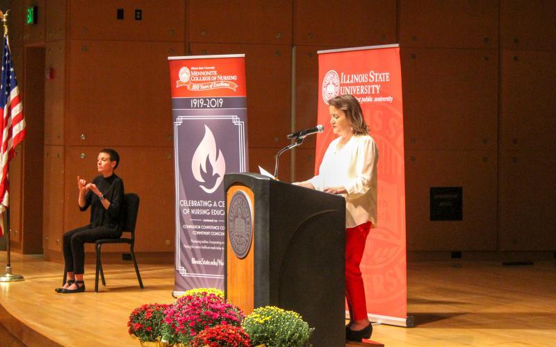 Susan Kalter speaks at podium