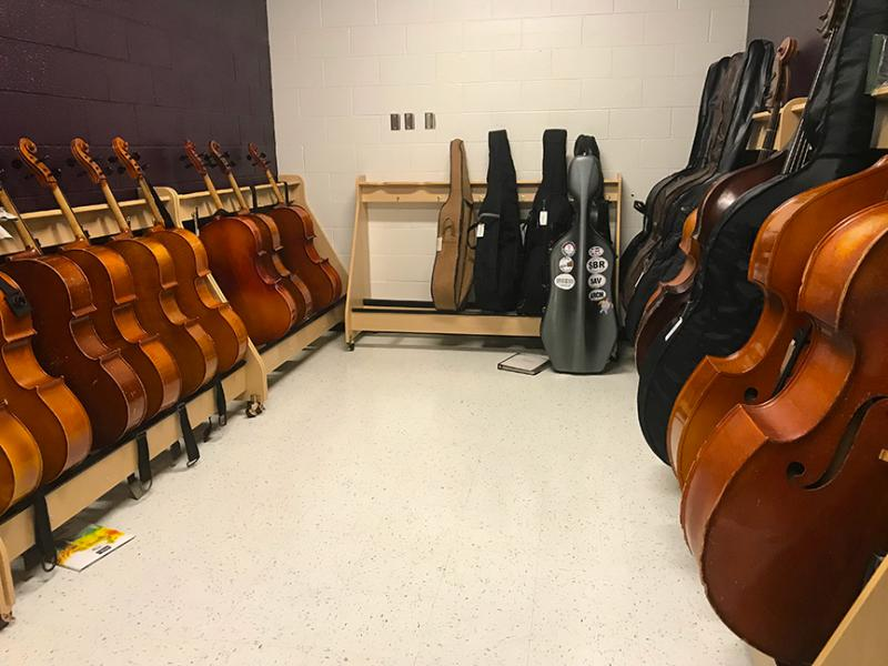 instruments lined up against the wall of a spacious storage area