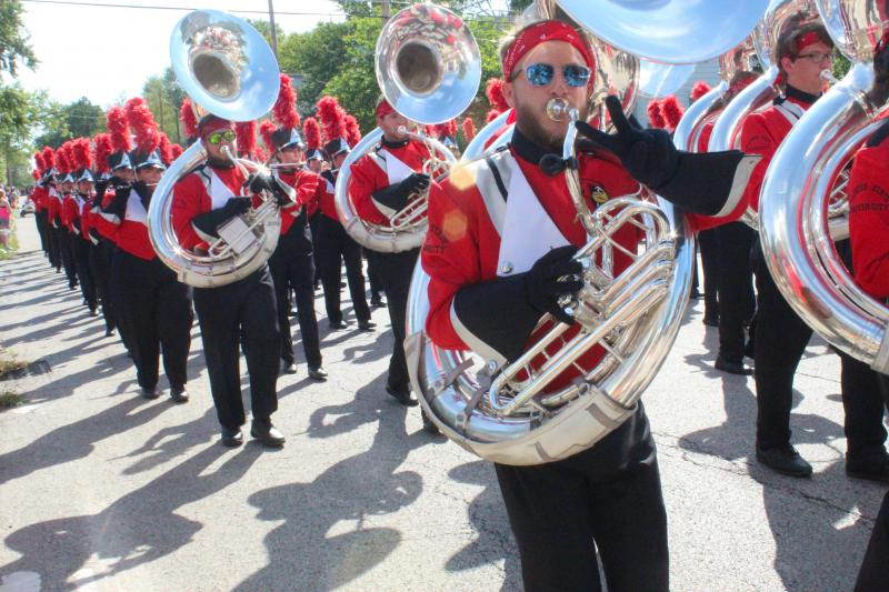 Tuba player marches
