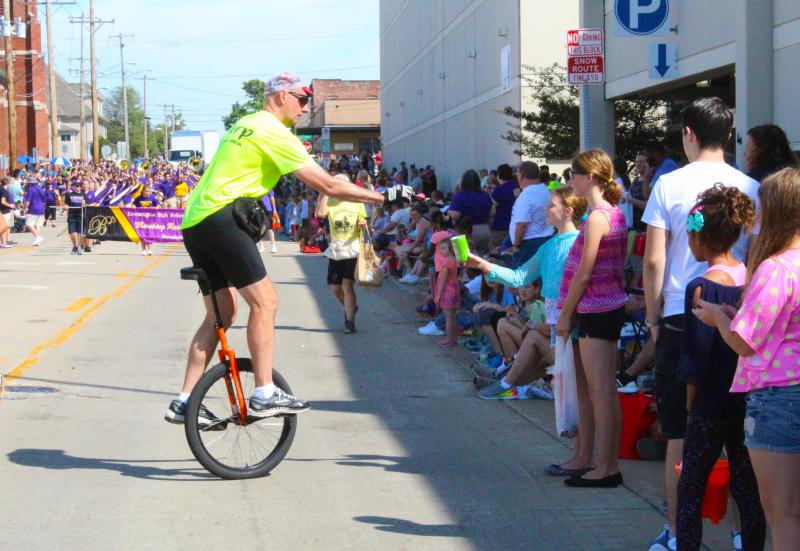 unicyclist gives out candy