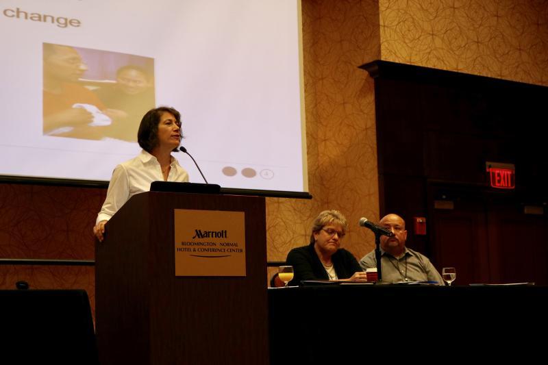Diana Rauner speaks at podium