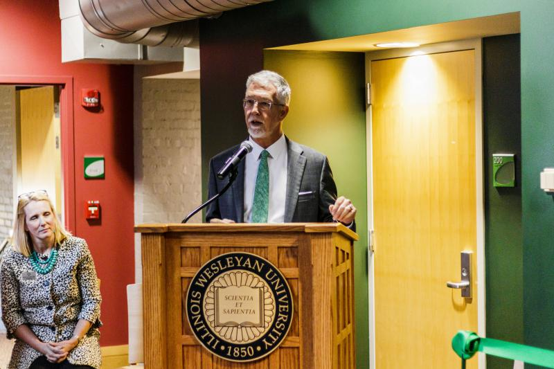 Illinois Wesleyan University President Eric Jensen speaking at esports arena ribbon cutting ceremony.