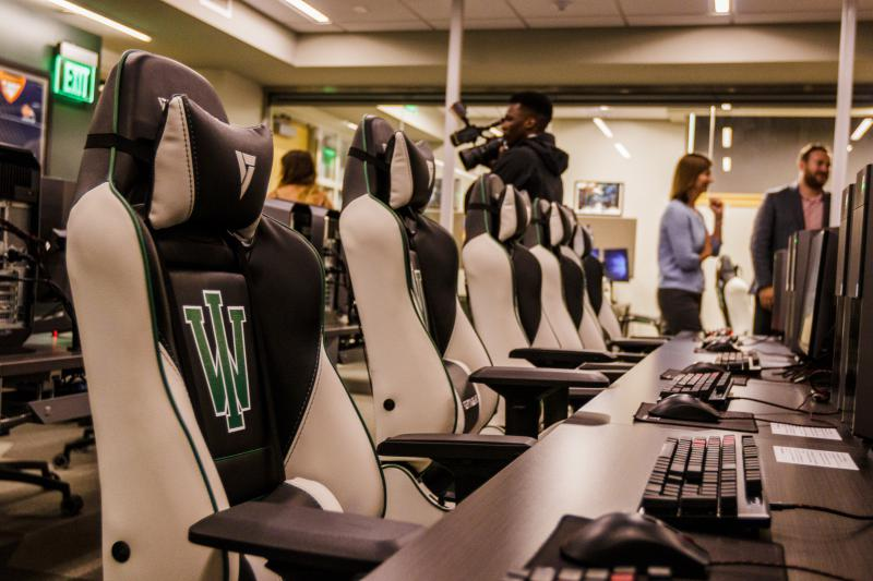 Illinois Wesleyan University esports arena- new desktops and branded chairs.