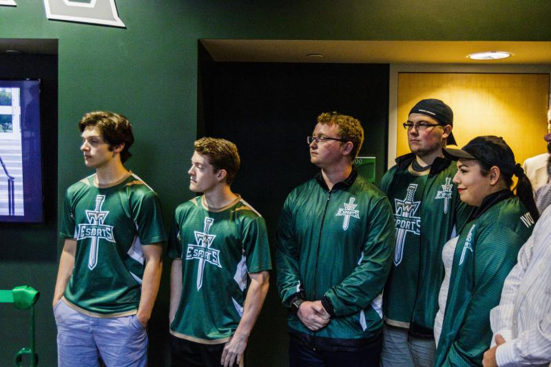 Students from Illinois Wesleyan University's esports team attend ribbon cutting ceremony.