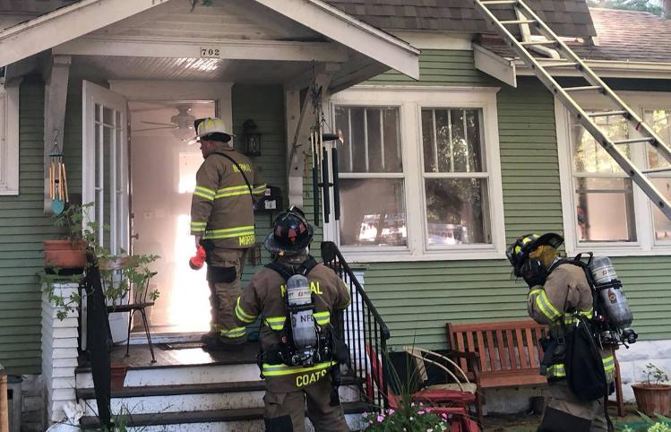 Firefighters enter a home