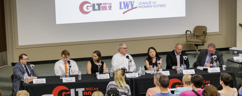 From left, McLean County Board candidates Mark Johnson, Logan Smith, Elizabeth Johnston, David Selzer, Sharon Chung, and Ryan Scritchlow with GLT news director and moderator Charlie Schlenker on Tuesday, Sept. 18, 2018.