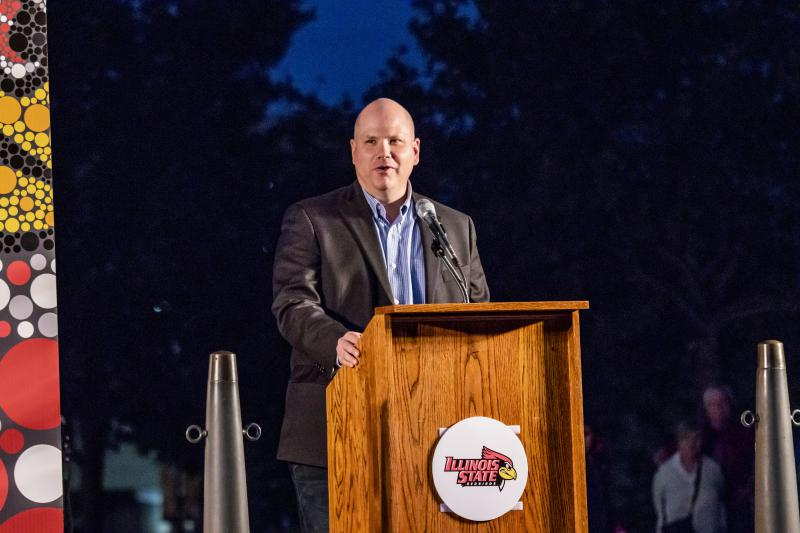 Normal Town Council member R.C. McBride (also GLT's general manager) speaks Monday during the Homecoming tree-lighting ceremony in Uptown Normal.