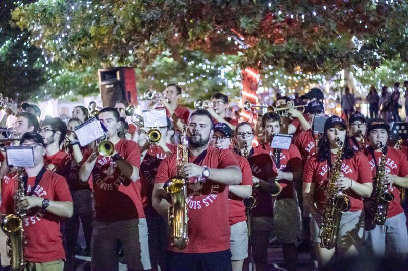 Jonathan Childs, front center, and the Big Red Marching Machine perform Monday in Uptown Normal.