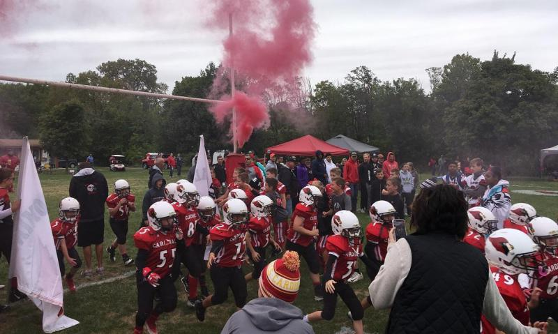 Members of the Bloomington Cardinals take the field at Ewing Park II before a game on Sept. 22.