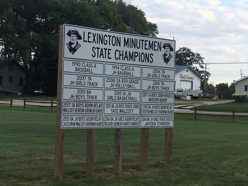 A sign as you enter Lexington shows each of its athletic state champions.