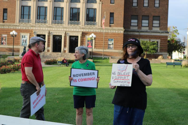 Protesters outside BCPA hold signs