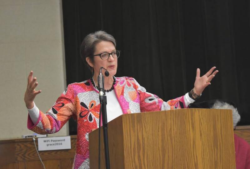 Sally Dyck speaks at podium