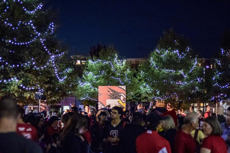 Uptown Normal trees are lit red and white in celebration of the start of Illinois State University Homecoming.