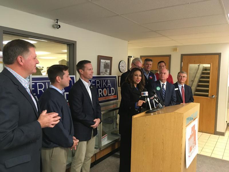 Erika Harold speaks surrounded by GOP candidates