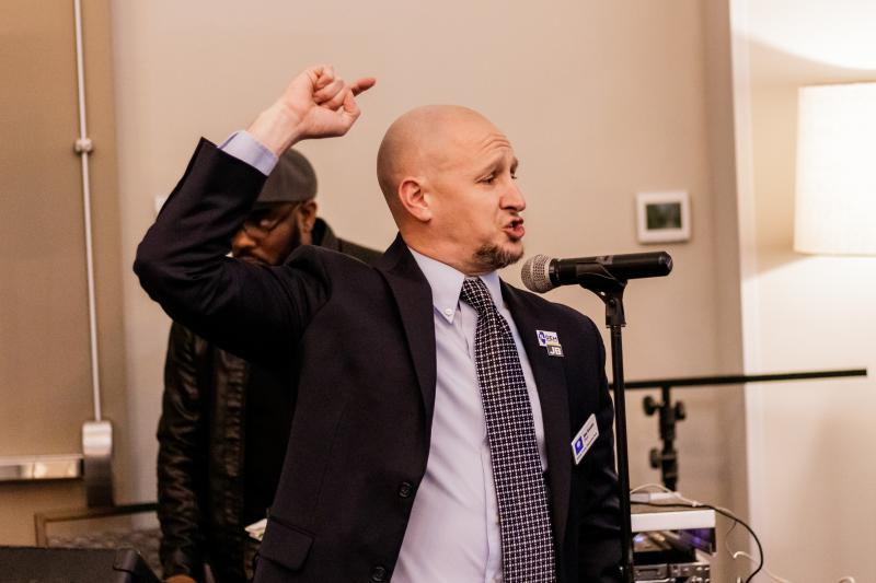 McLean County Democratic Party chair Erik Rankin rallies the crowd Tuesday night.