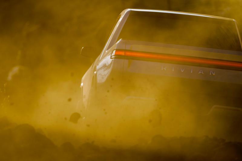 truck drives through dirt