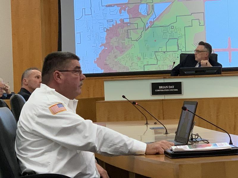 Normal Fire Chief Mick Humer answers questions at the Normal Town Council meeting Nov. 5, 2018.