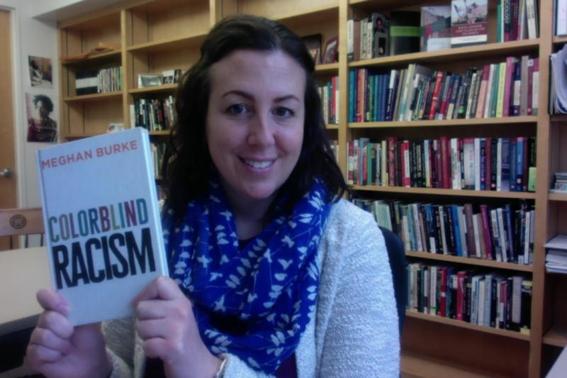 "Meghan Burke with her new book ""Colorblind Racism"""
