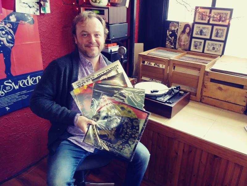 Reverberation Vinly's John Anderson holding various Masaki Batoh album covers