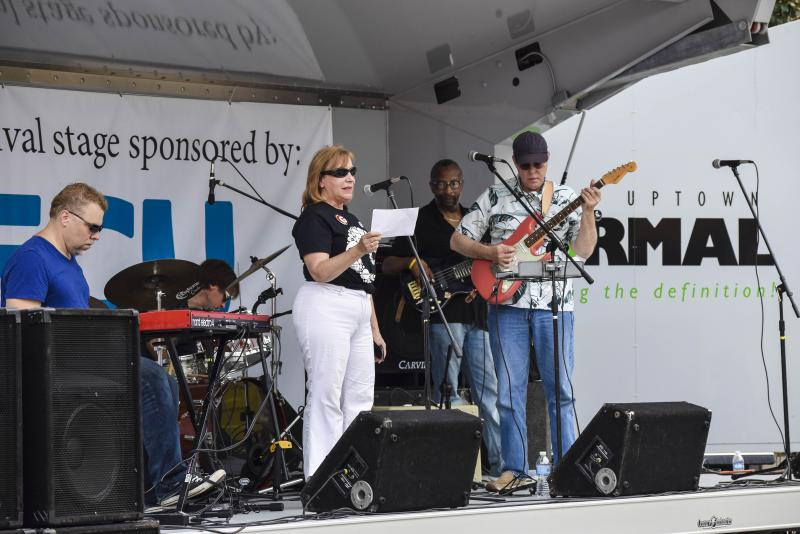 GLT's Judy Valente introduces the Joe Zaklan Band at the Sweet Corn Blues Festival on Saturday, Aug. 26, 2017, in Uptown Normal.