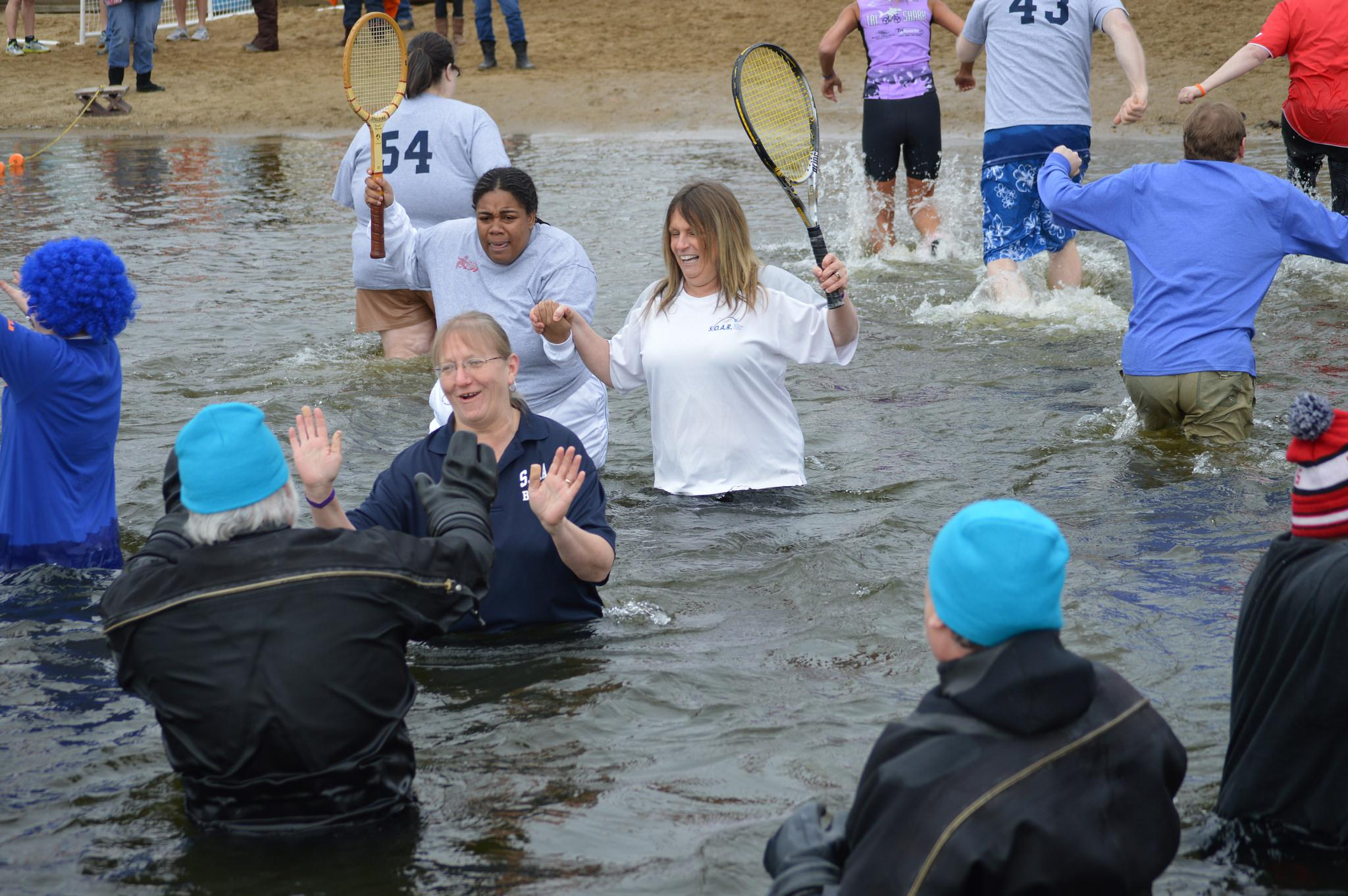 Dozens plunge into cold water raising money for Special Olympics