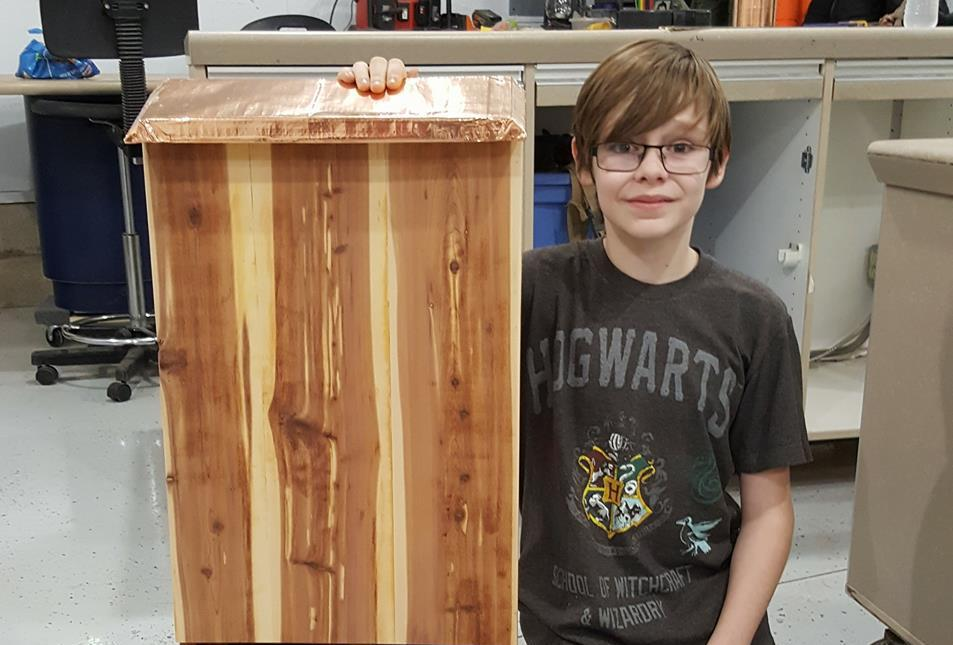 Ryan Cavinder, 12, Of Bloomington With The First Bat House He Ever Built.
