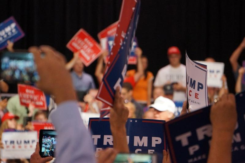 File photo: Supporters wave campaign signs at an August Donald Trump rally in Dimondale, MI.